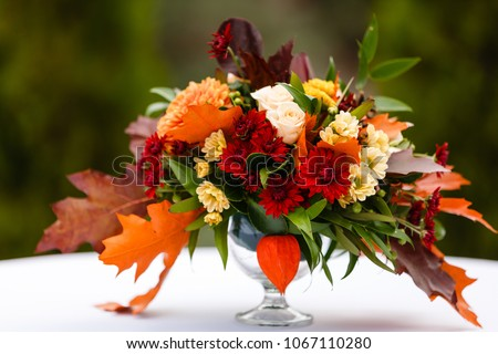 autumn flower composition with roses, chrysanthemum and maple leaves #1067110280