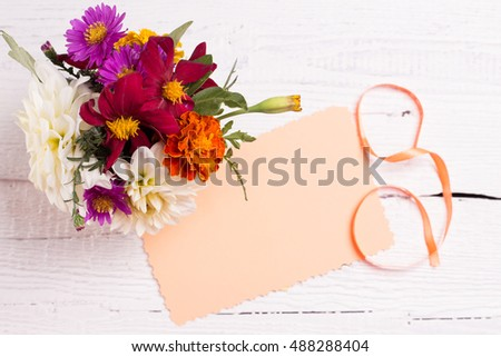 autumn flowers and card for your text on a background white board