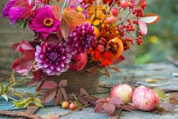 Autumn flowers closeup background, fall flowers bouquet, florist composition with dahlia and apples