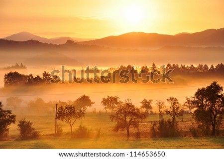 Autumn fog and the beautiful morning sun in a landscape