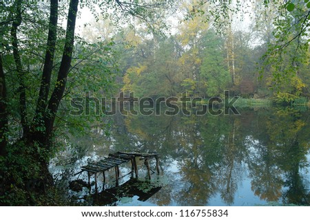 Autumn fog over the river - stock photo