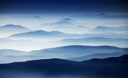 Autumn foggy landscape in Parang Mountains, Romania, Europe