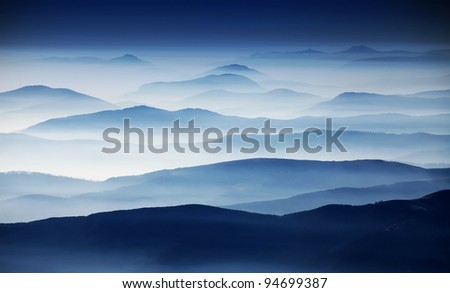 Autumn foggy landscape in Parang Mountains, Romania, Europe