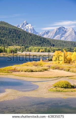 Autumn foliage in the Grand Teton mountain range - stock photo