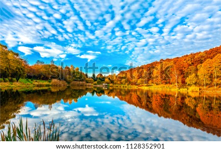 Autumn forest lake reflection landscape. Forest lake trees in autumn season panorama. Autumn lake in autumn forest.