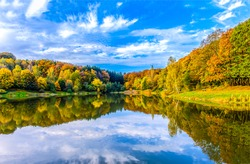 Autumn forest lake water reflection. Forest lake in autumn. Autumn forest lake reflection landscape. Autumn lake view