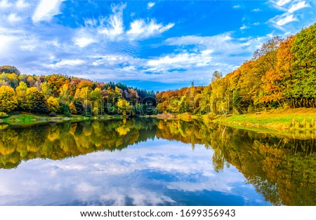 Photo of  Autumn forest lake water reflection. Forest lake in autumn. Autumn forest lake reflection landscape. Autumn lake view