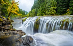 Autumn forest river waterfall view. Forest river waterfall. River waterfall. Waterfall river in forest