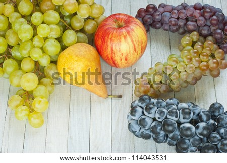autumn fruit still life, bright wooden table background