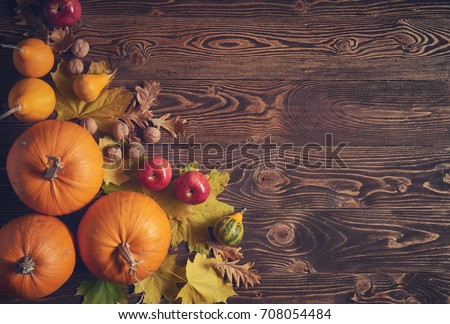 Autumn fruits and vegetables over wooden background, top view, flat lay, toned image