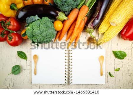 Autumn fruits, vegetables and open cookbook. Thanksgiving, healthy food, dieting vegetarian food, cooking concept. Top view, copy space