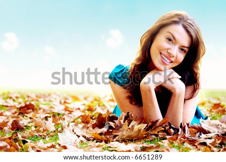 autumn girl portrait outdoors with a blue sky in the background