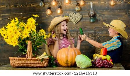 Autumn harvest festival. Children play vegetables pumpkin. Kids girl boy wear cowboy farmer style hat celebrate harvest festival. Celebrate fall traditions. Elementary school fall festival idea.