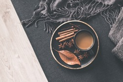 Autumn home decor. Cup of coffee, cinnamon sticks, anise stars on wooden tray. Autumn, fall concept. Flat lay, top view