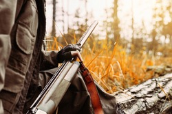 Autumn hunting season. Woman hunter with a gun. Hunting in the woods.