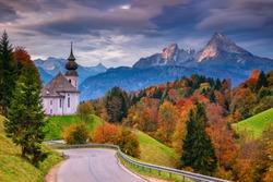 Autumn in Alps. Image of the Bavarian Alps with Maria Gern Church and Watzmann mountain during beautiful autumn sunrise.