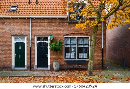 Autumn in city scene. City house in autumn