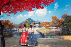 Autumn in Gyeongbokgung Palace and Korean national dress in Seoul,South Korea.