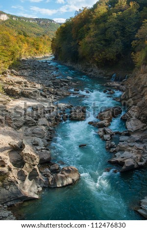 Autumn in mountains. River in canyon