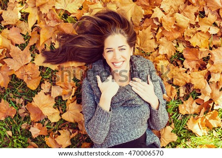 autumn in park young smiling...