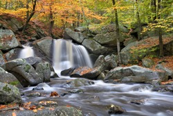 Autumn in scenic New England. Waterfall (Trap Falls), large boulders, and rushing brook in Willard Brook State Forest, Massachusetts.