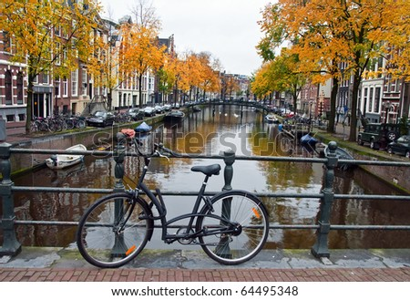 Autumn in the Netherlands with canal and bicycle