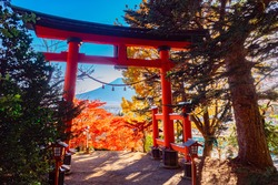 Autumn Japan. Red gate of the temple. Kawaguchi Asama Temple. Red torii on the background of autumn trees. View of mount Fuji. Kawaguchiko nature Park. Autumn in Japan. Nature Of Japan.