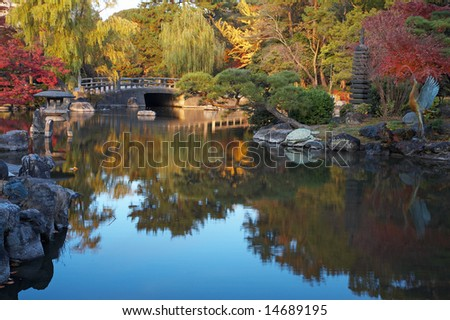 Autumn japanese landscape with pond and trees