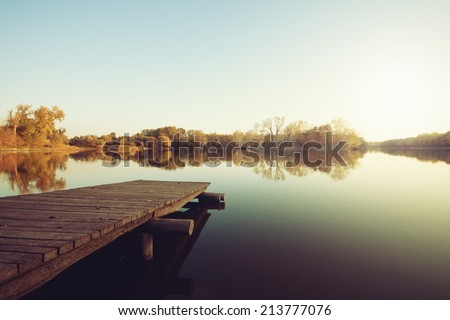 Stock Photo Autumn lake with wooden dock