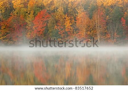 Autumn landscape at dawn of Moccasin Lake in fog, Michigan\'s Upper Peninsula, USA