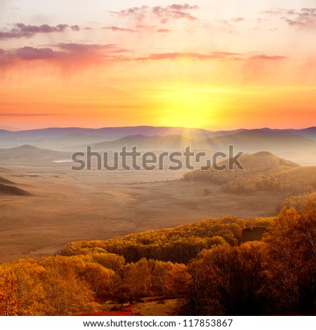 Autumn landscape at sunrise