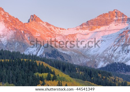 Autumn landscape at sunset, San Juan Mountains with conifers and aspens, Colorado, USA
