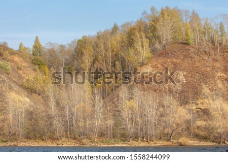 Autumn landscape, dark blue water, last warm days, river, trees, windy weather, yellow-red autumn leaves #1558244099