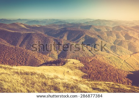 Autumn landscape in mountain valleys.Filtered image:cross processed vintage effect.
