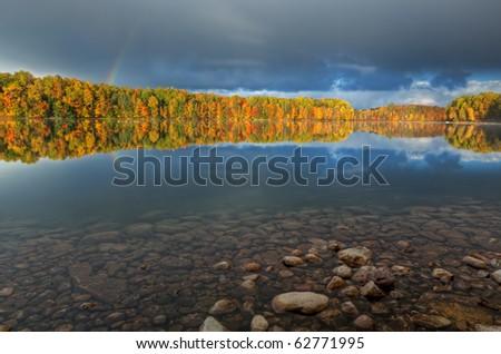 Autumn landscape of Moccasin Lake with rainbow, Michigan's Upper Peninsula, USA