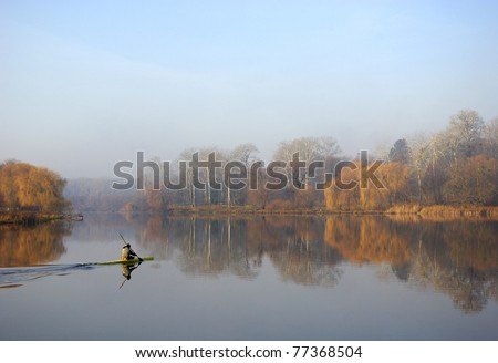 autumn landscape river in the morning, autumn. person moves in a kayak