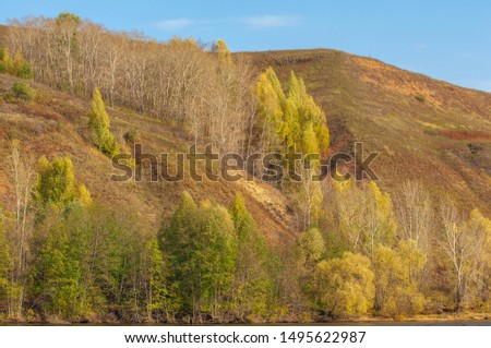 Autumn landscape, river, windy weather, dark blue water, yellow-red autumn leaves on trees, last warm days #1495622987
