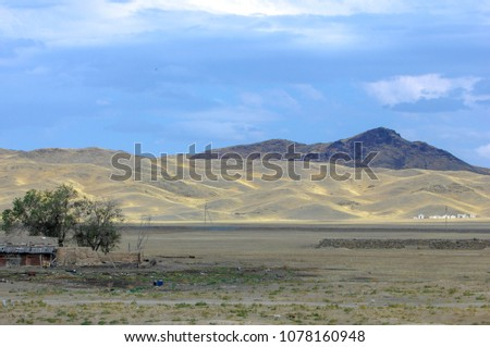 Autumn landscape, steppe with mountains. prairie, veld, veldt. a large open area of grassland, open, uncultivated country or grassland #1078160948
