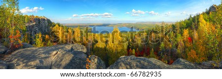 autumn landscape with mountains and lake