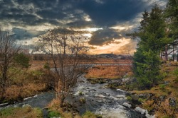 Autumn landscape with riverbank at sunset. Wonderful nature, beautiful natural background.