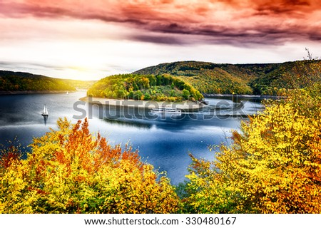 Autumn landscape with spectacular sunset over river #330480167