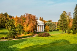 Autumn landscape with temple of Friendship is in Pavlovsk Park. St. Petersburg, Russia