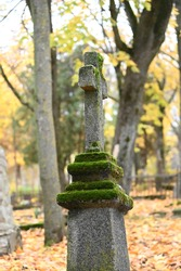 autumn, late, thoughtful concrete cross in the old cemetery