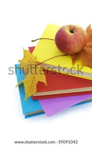 Autumn leafs, books and apple.