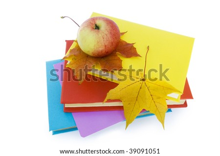 Autumn leafs, books and apple.