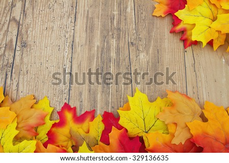 Autumn Leaves and Weathered Wood Background, Autumn Leaves on Weathered Grunge Wood with space for your message