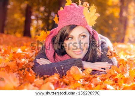 autumn leaves female lying ground - stock photo