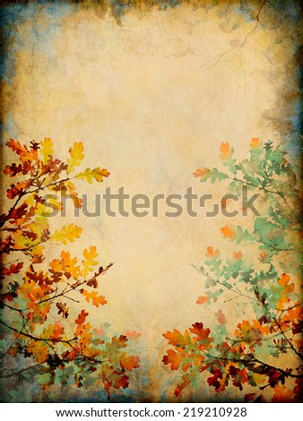 Autumn leaves on a grunge paper background.  Image displays a distinct paper grain and texture at 100 percent.