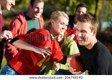 stock photo: friends playing football
