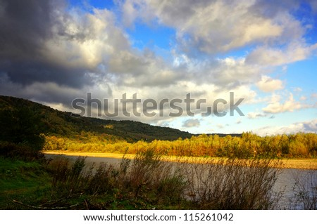 Autumn morning on the shore of a mountain river